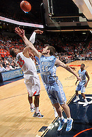North Carolina Tar Heels forward Tyler Zeller (44) reaches for the rebound with Virginia Cavaliers forward Akil Mitchell (25) during the game in Charlottesville, Va. North Carolina defeated Virginia 54-51.