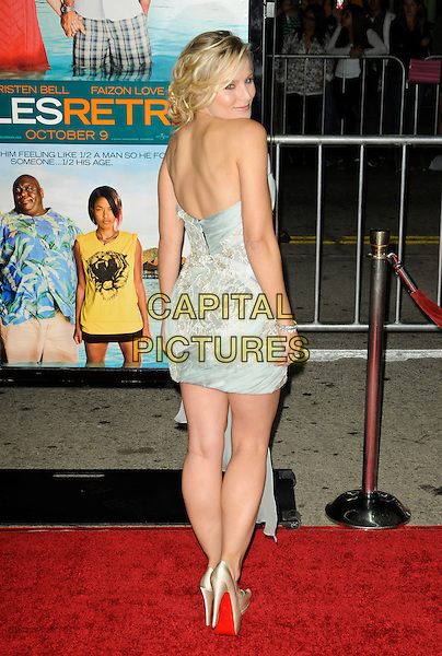 "KRISTEN BELL.The American premiere of ""Couples Retreat"" at Mann Village Theatre in Westwood, California, USA..October 5th, 2009.full length strapless dress white grey gray green christian louboutin shoes looking over shoulder.CAP/ROT.©Lee Roth/Capital Pictures"