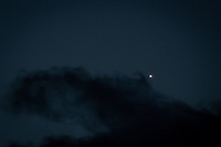 Venus, shining in the evening sky, just above the clouds that in a few  moments will envelop and hide it from view.
