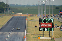 Jun. 29, 2012; Joliet, IL, USA: Overall view of NHRA pro stock driver Warren Johnson crossing the finish line during qualifying for the Route 66 Nationals at Route 66 Raceway. Mandatory Credit: Mark J. Rebilas-