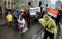 Nederland -  Amsterdam - 10 Maart 2019.  De Klimaatmars. De protestmars trekt in de stromende regen door het centrum van Amsterdam.  Foto mag niet in negatieve / schadelijke context worden gepubliceerd.