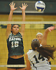 Seaford No. 16 Sophie Dandola, left, defends against a spike attempt by Lynbrook No. 14 Georgia Krendel during the Nassau County varsity girls' volleyball Class B final at SUNY Old Westbury on Wednesday, Nov. 11, 2015. Seaford won 3-0.<br /> <br /> James Escher
