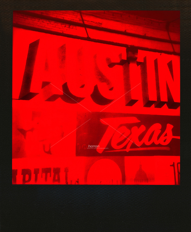 """Polaroid instant film picture of the famous """"Austin Texas"""" mural, the gateway to the dirty 6th Street bar district in downtown Austin, Texas - Stock Image."""
