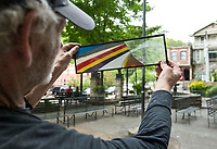 NWA Democrat-Gazette/BEN GOFF @NWABENGOFF<br /> Randy Woodward of The SandCastle Silica & Glass in Eureka Springs displays a finished example of the silica and glass art Tuesday, May 14, 2019, at Basin Spring Park in Eureka Springs. Woodward is a regular at the park, teaching visitors how to make their own silica art.