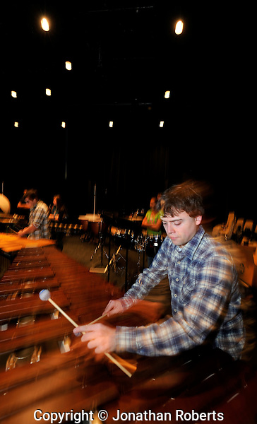 Youth Performing Arts School Percussion students under the direction of Todd Parker practice a score written for the school by composer David Maslanka.