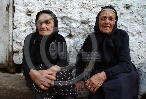 Lin-Pogradec-Albania - August 02, 2004---Two elderly women at/from the village of Lin taking a rest in front of a house; region/village of project implementation by GTZ-Wiram-Albania (German Technical Cooperation, Deutsche Gesellschaft fuer Technische Zusammenarbeit (GTZ) GmbH); people-portrait---Photo: Horst Wagner/eup-images