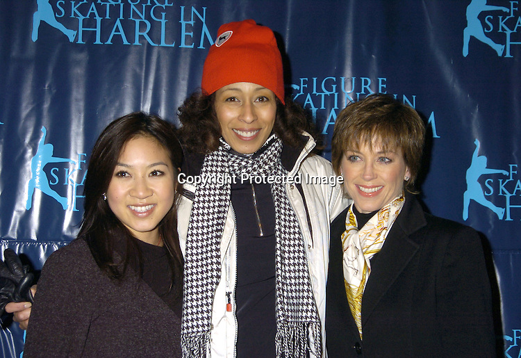 Michelle Kwan and Dorothy Hamill with Tamara Tunie ..at The Figure Skating in Harlem Benefit on February 7,2005 at The Wollman Rink. ..Photo by Robin Platzer, Twin Images
