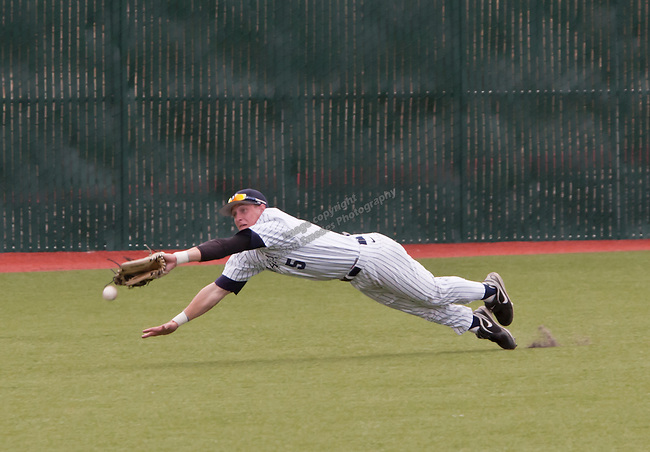 March 30, 2012:   Nevada Wolf Pack centerfielder Jamison Rowe dives for a ball against the BYU Cougars during their NCAA baseball game played at Peccole Park on Friday afternoon in Reno, Nevada.