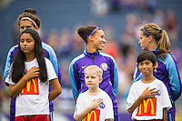 Orlando, FL - Sunday July 10, 2016: Sarah Hagen, Kristen Edmonds, Maddy Evans, escort kids prior to a regular season National Women's Soccer League (NWSL) match between the Orlando Pride and the Boston Breakers at Camping World Stadium.