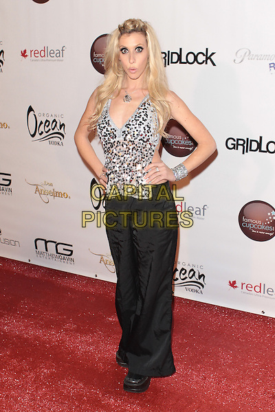 """AUBREY FISHER .""""Gridlock New Year's Eve Bash"""" held at Paramount Studios, Hollywood, California, USA,  31st December 2009..NYE full length hands on hips black trousers silver top sequined sequin bracelet discs paillettes .CAP/ADM/TC.©T. Conrad/AdMedia/Capital Pictures."""