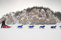 Lance Mackey runs on the Yukon River shortly after leaving Ruby checkpoint during the 2010 Iditarod
