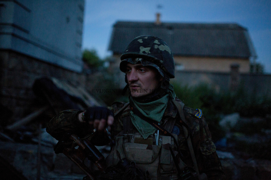 UKRAINE, Pisky: Vladimir is going on a night mission in the trenches of the frontline.<br />