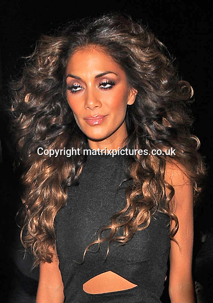 NON EXCLUSIVE PICTURE: PALACE LEE / MATRIXPICTURES.CO.UK<br /> PLEASE CREDIT ALL USES<br /> <br /> WORLD RIGHTS<br /> <br /> American media personality and singer Nicole Scherzinger is pictured as she leaves The Cuckoo Club, in London.<br /> <br /> The X Factor judge looks glamorous in a little black dress.<br /> <br /> NOVEMBER 2nd 2013<br /> <br /> REF: LTN 137129