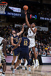 Doral Moore (4) of the Wake Forest Demon Deacons shots over Nikola Djogo (13) and Elijah Burns (12) of the Notre Dame Fighting Irish during first half action at the LJVM Coliseum on February 24, 2018 in Winston-Salem, North Carolina. The Fighting Irish defeated the Demon Deacons 76-71.  (Brian Westerholt/Sports On Film)
