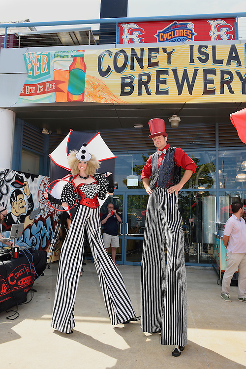 Characters on stilts for the grand opening celebration of Coney Island Brewery.