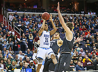 Washington, DC - March 11, 2018: Rhode Island Rams guard Jeff Dowtin (11) takes a shot during the Atlantic 10 championship game between Rhode Island and Davidson at  Capital One Arena in Washington, DC.   (Photo by Elliott Brown/Media Images International)