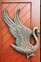 Swan figure on red doorway to St. Columba's Church, Drumcliffe, County Sligo, Republic of Ireland