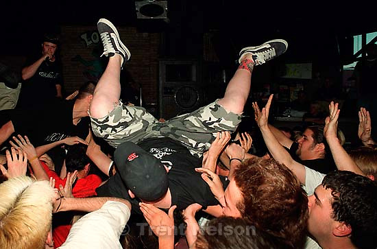 Stage diver at Earth Crisis at Brick's Club.<br />
