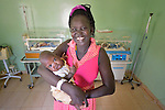 "Achol Malek holds her son Chol Madhol at the St. Daniel Comboni Catholic Hospital in Wau, South Sudan. The boy was born almost three months prematurely in December 2014, yet survived because of the hospital's incubators. His family has nicknamed him ""Comboni."""