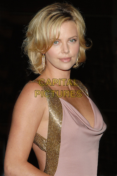 CHARLIZE THERON.9th Annual Hollywood Film Festival held at the Beverly Hilton Hotel..USA, United States.24th October 2005.Ref: ADM/JW.half length pink gold sequin sequinned plunging neckline top eye contact posed.www.capitalpictures.com.sales@capitalpictures.com.© Capital Pictures.