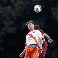 Syracuse University midfielder Juuso Pasanen (6) battle for head ball. Boston College (maroon) defeated Syracuse University (white/orange), 3-2, at Newton Campus Field, on October 8, 2013.