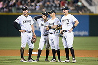 (L-R) Patrick Leonard (20), Eddy Alvarez (10), Juan Perez (4), and Matt Skole (12) of the Charlotte Knights wait for a pitching change during the game against the Indianapolis Indians at BB&T BallPark on May 26, 2018 in Charlotte, North Carolina. The Indians defeated the Knights 6-2.  (Brian Westerholt/Four Seam Images)