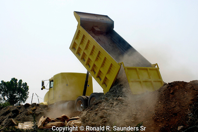 DUMP TRUCK ONLOADS ROCKS AND DIRT IN MEXICO