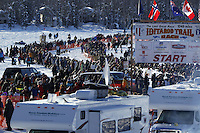 Sunday, March 4, 2012  A crowd of spectators lined the starting chute at the restart of Iditarod 2012 in Willow, Alaska.