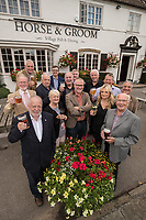 Licensee of the Horse & Groom at Linby, Graeme Beal is pictured centre receiving a toast from the Rotary Club of Hucknall