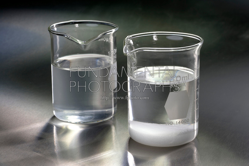 COMPARISON CONCENTRATED AND SATURATED NaCl<br /> Two beakers of NaCl at different saturations<br /> Concentrated NaCl (aq) is less saturated compared to solution in equilibrium with solid NaCl at 20&deg;C. Solid crystals are constantly dissolving, while ions in the solution are constantly precipitating. The concentration  remains constant.