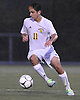 Chris Schmidt #11 of Massapequa moves the ball upfield during the Nassau County Class AA varsity boys soccer playoffs against Syosset at Adelphi University on Sunday, Oct. 30, 2016. Thunder, lightning and heavy rain necessitated a delay nine minutes into the second half a scoreless match.