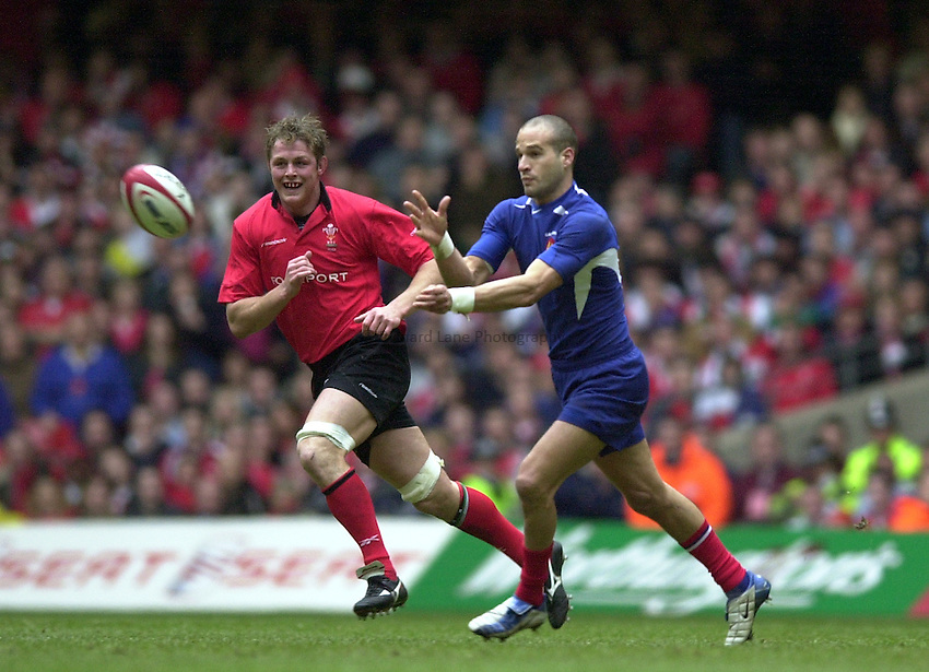 Photo. © Peter Spurrier/Richard Lane Photography.07/03/2004 Six Nations Rugby - Wales v France.Frederic Michalak throws the ball out before Dafydd Jones [left] can challenge. ...