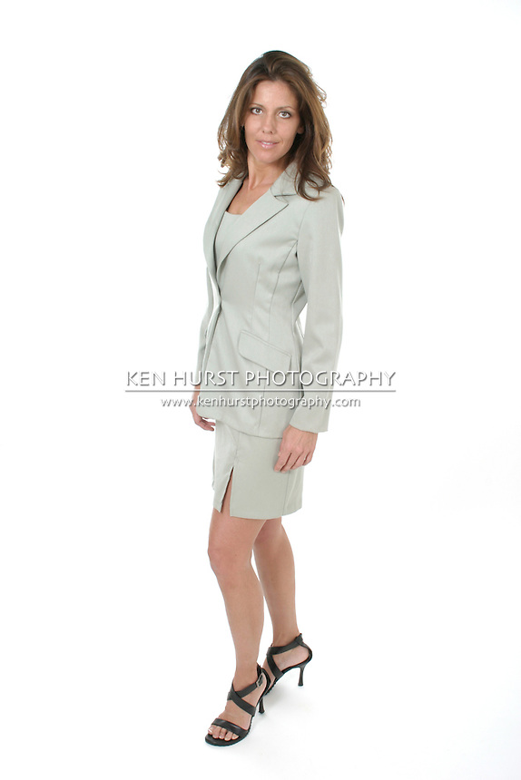 Beautiful brunette executive business woman in a business suit.