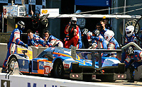 The #10 Peugeot 908 of Nicolas Lapierre, Loic Duval and Olivier Panis makes a pit stop during the 12 Hours of Sebring, Sebring International Raceway, Sebring, FL, March 19, 2011.  (Photo by Brian Cleary/www.bcpix.com)