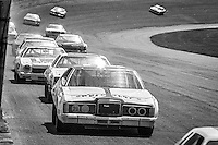 David Pearson, #21 Mercury, leads a pack of cars en route to victory, 1978 Firecracker 400 NASCAR race, Daytona International Speedway, Daytona Beach, FL, July 4, 1978.  (Photo by Brian Cleary/ www.bcpix.com )