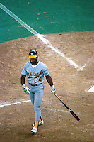 CINCINNATI, OH - Rickey Henderson of the Oakland Athletics walks away from home plate during Game 1 of the 1990 World Series against the Cincinnati Reds at Riverfront Stadium in Cincinnati, Ohio in 1990. Photo by Brad Mangin