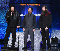 "Matt Pike, from left, Des Kensel and Jeff Matz, of Electric Messiah, accept the award for best metal performance for ""High On Fire"" at the 61st annual Grammy Awards on Sunday, Feb. 10, 2019, in Los Angeles. (Photo by Matt Sayles/Invision/AP)"