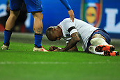 27th March 2018, Wembley Stadium, London, England; International Football Friendly, England versus Italy; Ashley Young of England goes down injured off the field and rolls back on to get a stop in play