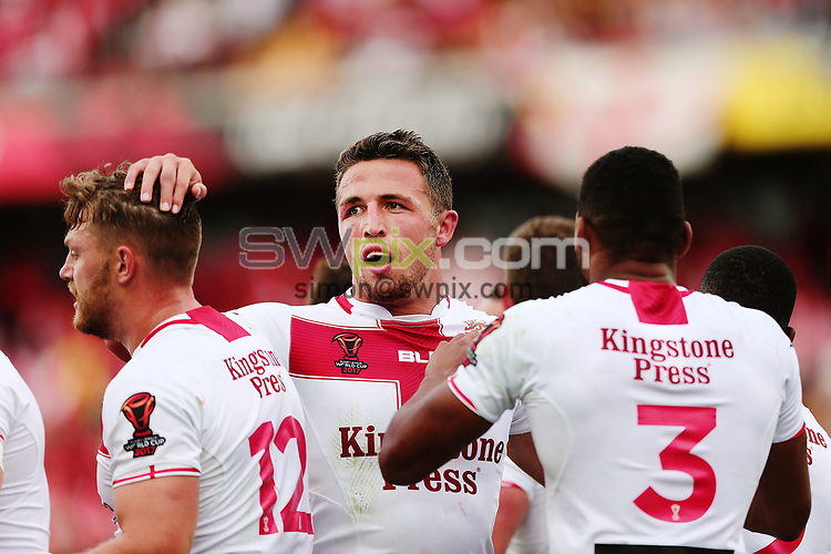 Sam Burgess of England celebrates with the team on Gareth Widdop's try. 2017 Rugby League World Cup Semi Final, England v Tonga at Mt Smart Stadium, Auckland, New Zealand. 25 November 2017 © Copyright Photo: Anthony Au-Yeung / www.photosport.nz MANDATORY BYLINE/CREDIT : Andrew Cornaga/SWpix.com/PhotosportNZ