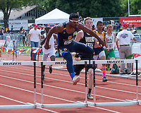 John Burroughs senior Ezekiel Eliott hurdles his way to the Class 3 300-meter hurdle title at the 2013 Missouri High School State Track and Field Championships in Jefferson City. The title was Elliott's third in just over two hours.