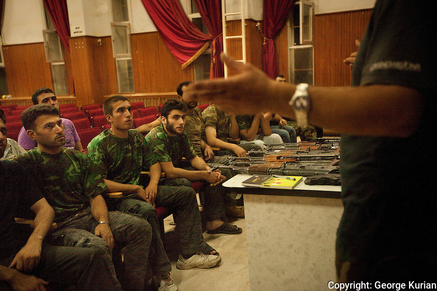 New recruits and volunteers to the FSA being trained by a defector army officer, who didn't want his face shown for fear of repercussions to his family.