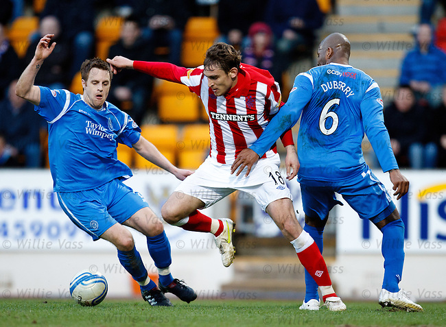 Nikica Jelavic skips past Alan Maybury and Michael Duberry