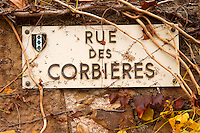 Roadsign Rue des Corbieres street. Chateau la Voulte Gasparets. In Gasparets village near Boutenac. Les Corbieres. Languedoc. France. Europe.