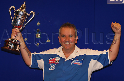 24.07.2011 World Match Play Darts from the Winter Gardens in Blackpool. Phil Taylor celebrates with the Sky Bet Trophy after winning the Final.