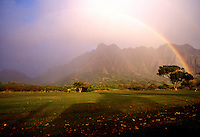 Rising sun creates a rainbow in front of the Koolau mountains on the windward side of Oahu.