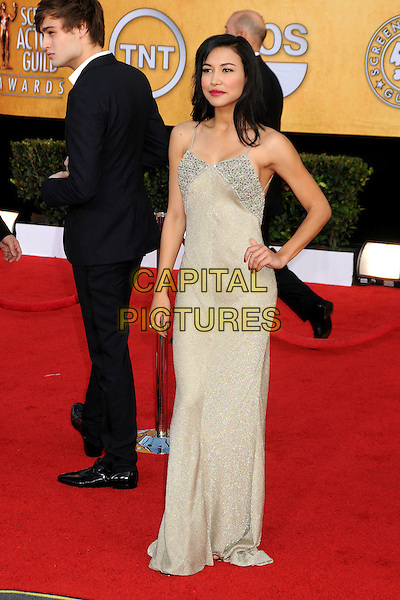 NAYA RIVERA.17th Annual Screen Actors Guild Awards held at The Shrine Auditorium, Los Angeles, California, USA..January 30th, 2011.arrivals full length beige dress hand on hip silver beads beaded SAG.CAP/ADM/BP.©Byron Purvis/AdMedia/Capital Pictures.