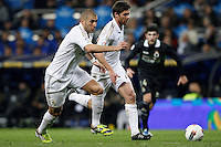 18.02.2012 SPAIN -  La Liga matchday 24th  match played between Real Madrid vs Racing (4-0) at Santiago Bernabeu stadium. The picture show Karim Benzema (French Forward of Real Madrid) and Xabier Alonso (Spanish midfielder of Real Madrid)