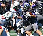 SIOUX FALLS, SD - SEPTEMBER 6: Nephi Garcia #3 from the University of Sioux Falls looks for room past Casey Weinmann #42 and Mitchell Matthias #7 from Minot State in the second quarter of their game Saturday afternoon at Bob Young Field in Sioux Falls.  (Photo by Dave Eggen/Inertia)