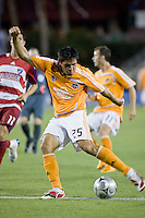 Houston Dynamo forward Brian Ching (25) strikes the ball.   Houston Dynamo and FC Dallas played to a 1-1 tie at Robertson Stadium in Houston, TX on June 26, 2008.