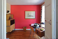 Study, with red wall, early 1950s furniture and modern typewriter, in the Historic Show Flat, on the first floor of an ISAI or Immeubles Sans Affectation Individuelle apartment block, designed from 1946 by Auguste Perret, 1874-1954, who led the reconstruction of Le Havre in the 1950s, after the town was completely destroyed in WWII, Le Havre, Normandy, France. The apartment, of early 1950s design, used all modern conveniences, including internal kitchen and bathroom, contemporary mass produced oak furniture, natural light flowing from front and back, children's study bedroom, central heating and domestic appliances such as vacuum cleaners and refrigerators. Rene Gabriel and Marcel Gascoin designed the furniture in Scandinavian style, which came to typify reconstruction design. The centre of Le Havre is listed as a UNESCO World Heritage Site. Picture by Manuel Cohen